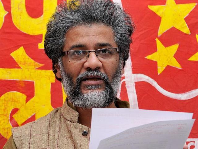 CPI-ML-general-secretary-Dipankar-Bhattacharya-presents-the-list-of-party-candidates-for-the-Lok-Sabha-polls-Diwakar-Prasad-HT-Photo