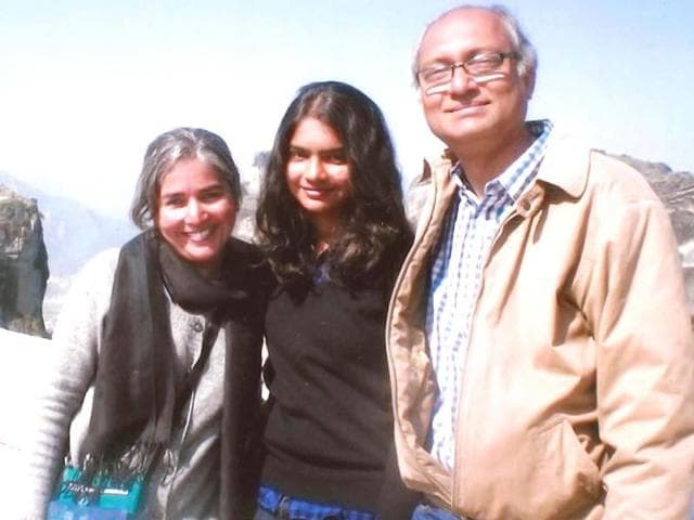 Chandrika-Sharma-L-was-one-of-the-239-people-on-board-the-ill-fated-MH370-flight-that-disappeared-while-on-its-way-to-Beijing-on-March-8-2014-In-this-photograph-she-is-seen-with-her-daughter-Meghna-and-husband-Narendran-Photo-special-arrangement