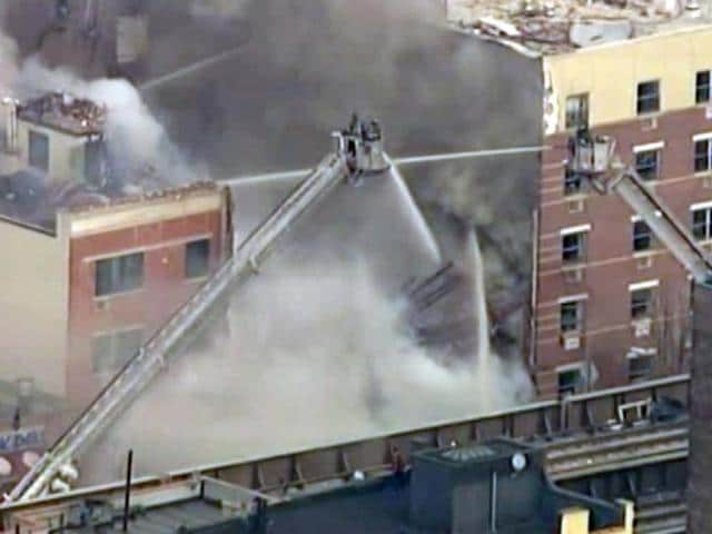Firefighters-battle-a-blaze-at-the-site-of-a-possible-explosion-and-building-collapse-in-the-East-Harlem-neighborhood-of-New-York-Image-taken-from-WABC-video-AP-Photo
