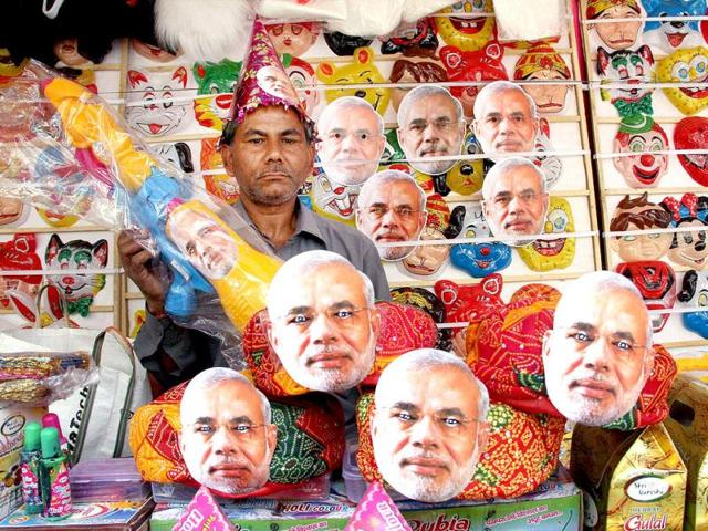 A-vendor-arranges-masks-of-BJP-prime-ministerial-candidate-Narendra-Modi-at-his-shop-in-Ranchi-PTI-Photo