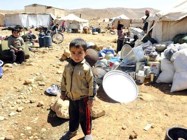 A-Syrian-refugee-child-who-fled-the-violence-from-the-Syrian-town-of-Flita-near-Yabroud-poses-for-a-photograph-at-the-border-town-of-Arsal-in-the-eastern-Bekaa-Valley-Reuters-Photo