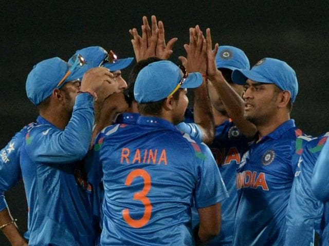 Indian cricketers celebrate the dismissal of Pakistan