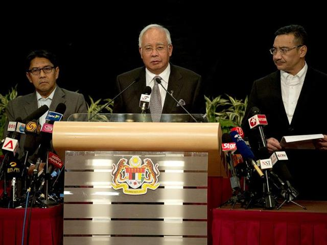 Malaysian-prime-minister-Najib-Razak-C-during-a-press-conference-on-flight-MH370-in-Kuala-Lumpur-AFP-photo