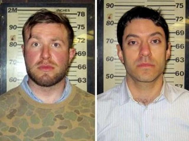 CNN-producers-Yon-Pomrenze-35-and-Connor-Fieldman-Boals-26-are-pictured-in-this-booking-photo-handout-courtesy-of-Port-Authority-of-New-York-REUTERS