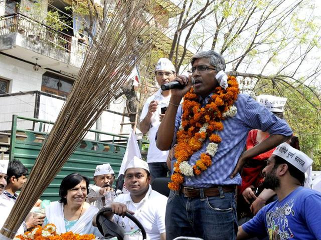 AAP-leader-Ashutosh-with-his-supporters-during-a-road-show-election-campaign-at-Shailmar-Bagh-area-in-New-Delhi-Sonu-Mehta-HT-photo