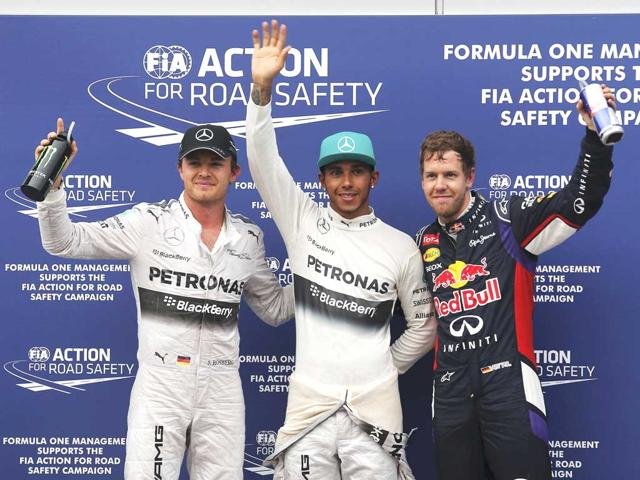Mercedes-Formula-One-driver-Lewis-Hamilton-of-Britain-with-Red-Bull-Formula-One-driver-Sebastian-Vettel-of-Germany-and-Mercedes-Formula-One-driver-Nico-Rosberg-of-Germany-after-the-qualifying-session-for-the-Malaysian-F1-Grand-Prix-at-Sepang-International-Circuit-Reuters