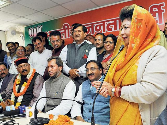 While-BJP-has-announced-candidates-for-all-5-LS-seats-Congress-is-still-mulling-over-the-possible-names-Here-BJP-leaders-take-part-in-public-meeting-in-Dehradun-HT-File-Photo