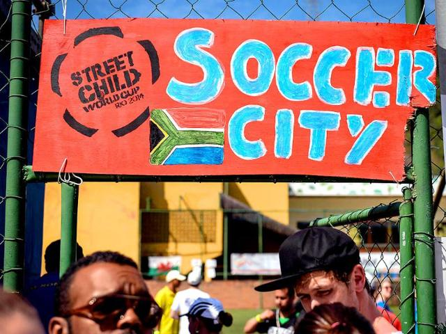 View-of-a-sign-at-the-entrance-of-the-Street-Child-World-Cup-in-Rio-de-Janeiro-Brazil-on-April-1-2014-About-230-boys-and-girls-from-19-countries-participate-in-the-10-day-long-tournament-AFP-Photo