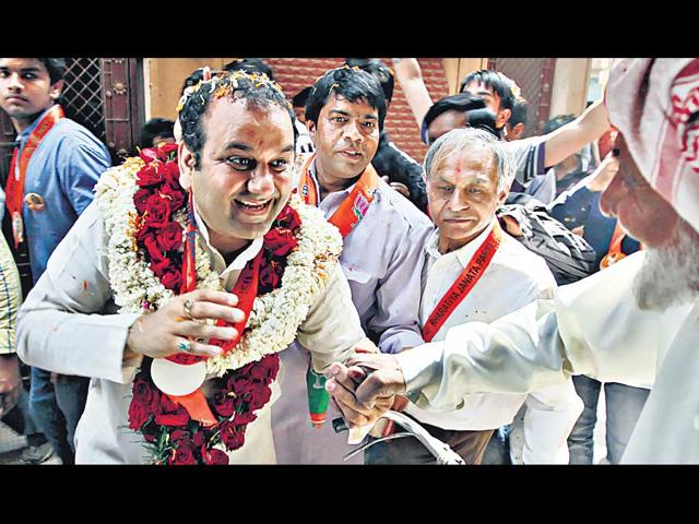 Mahesh-Girri-campaigns-in-an-east-Delhi-locality-on-Wednesday-He-is-pitted-against-sitting-MP-and-former-Delhi-CM-Sheila-Dikshit-s-son-Sandeep-Dikshit--HT-photo-Raj--K-Raj