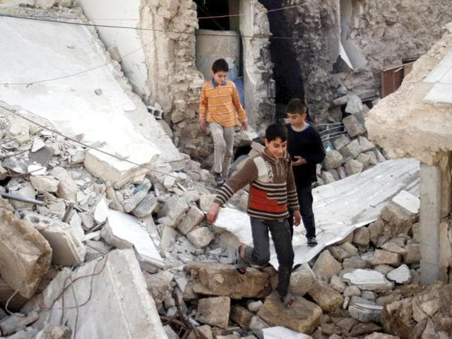 Boys-play-on-debris-of-damaged-buildings-in-the-old-city-of-Aleppo-Reuters-Photo