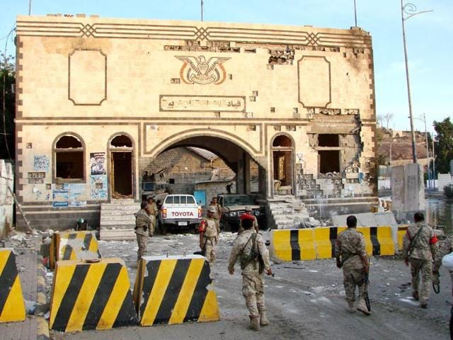 Yemeni-soldiers-inspect-the-scene-of-a-car-bomb-blast-outside-the-headquarters-of-a-Yemeni-army-complex-in-the-southern-port-city-of-Aden-Yemen-AP-Photo