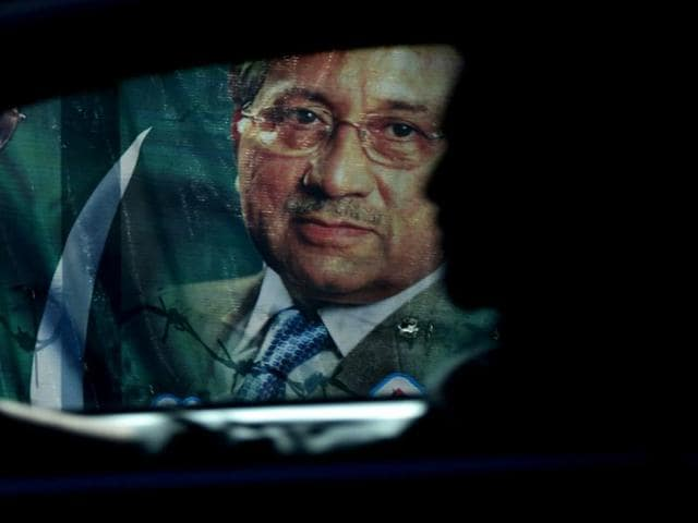 A-Pakistani-commuter-rides-past-a-poster-of-former-military-ruler-Pervez-Musharraf-in-Rawalpindi-AFP-Photo