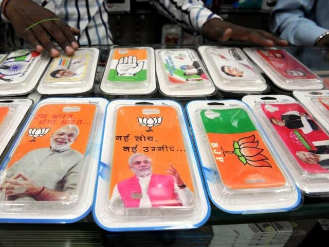 A-shopkeeper-displays-election-themed-snap-on-mobile-phone-covers-in-Mumbai-Snap-on-mobile-phone-covers-featuring-party-symbols-photos-and-messages-of-political-parties-have-flooded-the-market-as-entrepreneurs--try-to-cash-in-on-poll-mania-AFP-Photo
