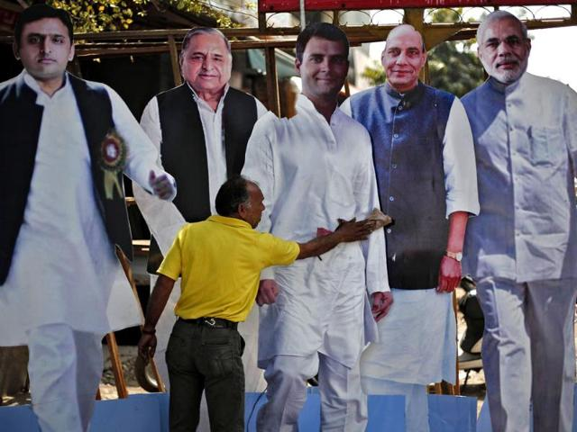A-worker-cleans-a-cut-out-of-Rahul-Gandhi-beside-cut-outs-of-Akhilesh-Yadav-Mulayam-Singh-Yadav-Rajnath-Singh-and-Narendra-Modi-as-they-are-put-on-display-for-sale-in-Ghaziabad--Reuters-Photo