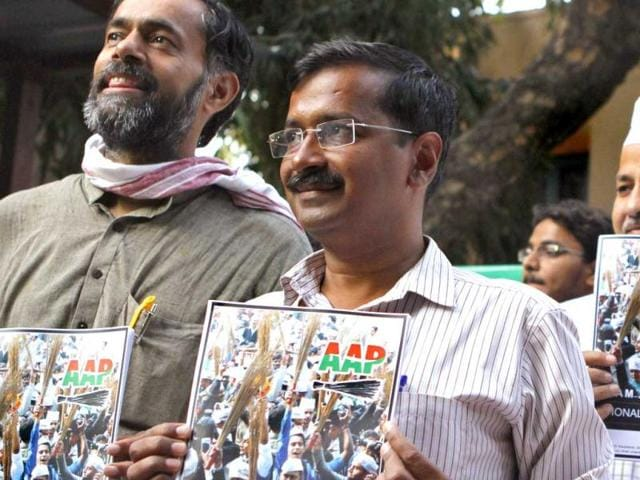Aam-Admi-Party-AAP-convener-Arvind-Kejriwal-C-poses-with-party-officials-as-he-releases-his-party-election-manifesto-at-a-press-conference-in-New-Delhi-India-Virendra-Singh-Gosain-HT-Photo
