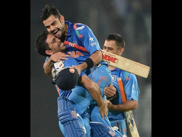 Yuvraj-Singh-picks-up-Virat-Kohli-2R-after-India-won-the-ICC-World-Twenty20-match-against-South-Africa-at-the-Sher-e-Bangla-National-Cricket-Stadium-in-Dhaka-AFP-Photo