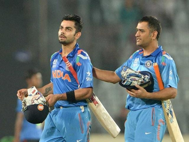 MS-Dhoni-R-greets-Virat-Kohli-L-after-India-won-the-ICC-World-Twenty20-match-against-South-Africa-at-the-Sher-e-Bangla-National-Cricket-Stadium-in-Dhaka-AFP-Photo