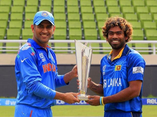 India-s-captain-M-S-Dhoni-L-and-Sri-Lanka-s-Lasith-Malinga-pose-with-the-trophy-of-ICC-Twenty20-World-Cup-at-the-Sher-E-Bangla-National-Cricket-Stadium-in-Dhaka-Reuters-Photo