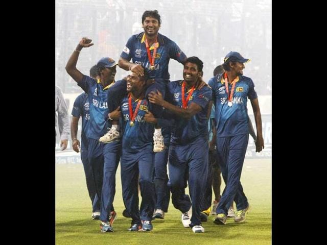 Sri-Lanka-s-players-lift-Kumar-Sangakkara-as-they-acknowledge-the-crowd-after-their-win-over-India-in-the-ICC-Twenty20-World-Cup-final-match-in-Dhaka-AP-Photo