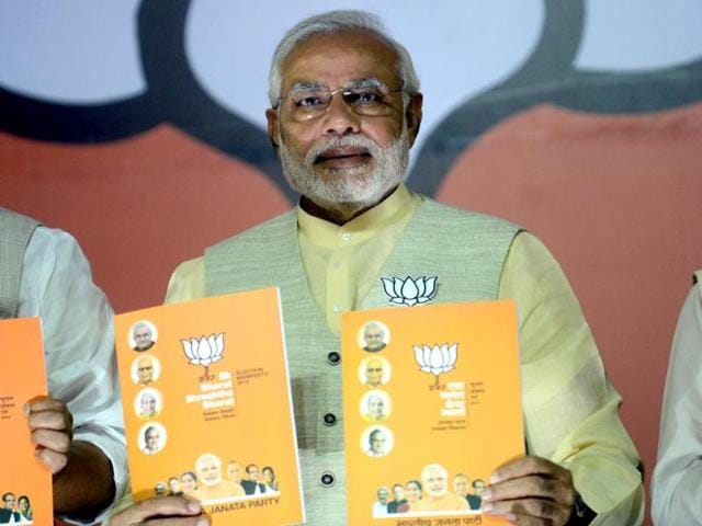 BJP-s-PM-nominee-Narendra-Modi-poses-alongisde-BJP-president-Rajnath-Singh-LK-Advani-Sushma-Swaraj-and-Murli-Manohar-Joshi-as-they-hold-up-the-party-manifesto-upon-its-release-in-New-Delhi-AFP-photo