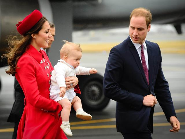 Catherine-the-Duchess-of-Cambridge-holds-her-son-Prince-George-after-disembarking-their-plane-with-her-husband-Britain-s-Prince-William-in-Wellington-Reuters-Photo