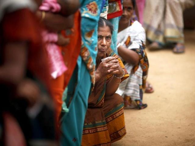 People-stand-in-queue-to-cast-their-votes-during-the-first-phase-of-Lok-Sabha-elections-in-Mandai-Tripura-on-Monday-India-began-the-world-s-largest-election-Monday-with-voters-in-the-remote-northeast-making-their-way-past-lush-rice-paddies-and-over-rickety-bamboo-bridges-to-reach-the-polls-The-country-s-814-million-electorate-will-vote-in-stages-over-the-next-five-weeks-AP-photo