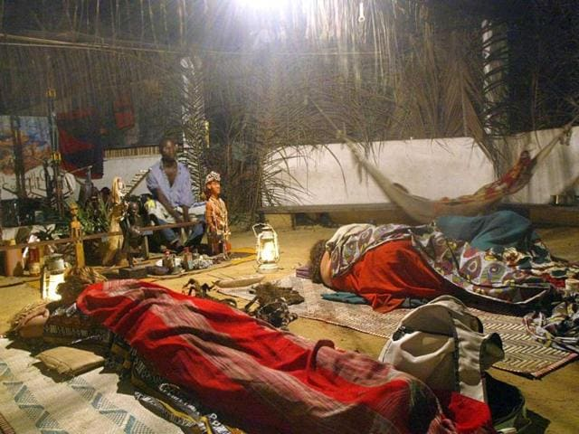 European-women-front-rest-in-a-temple-after-taking-Iboga-during-an-initiation-to-the-Bwiti-rite-in-Libreville-AFP
