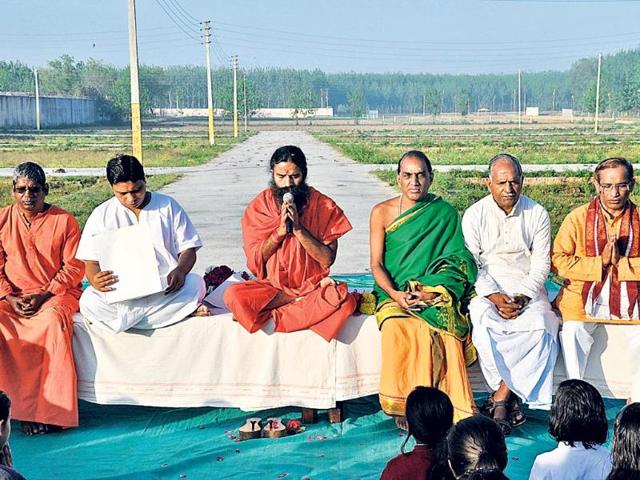 Yoga-guru-Ramdev-holds-a-session-outside-Patanjali-Yogpeeth-in-Haridwar-on-Tuesday-HT-Photo