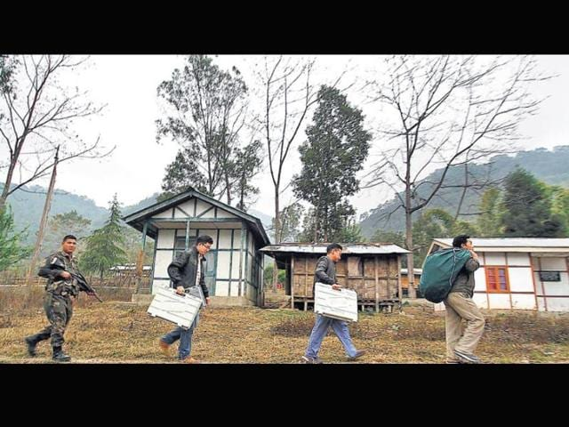 Electoral-staff-carry-EVMs-in-Jamri-village-of-Arunachal-Pradesh-on-Tuesday-the-eve-of-the-second-phase-of-LS-polls--Reuters