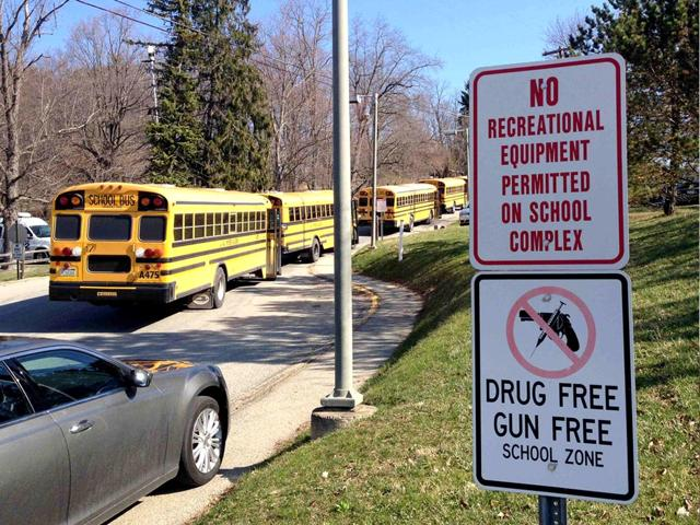 School-buses-are-parked-outside-Franklin-Regional-High-School-after-reports-of-stabbing-injuries-in-Murrysville-Pennsylvania-Twenty-students-were-injured-in-the-attack-and-four-of-the-victims-were-flown-to-area-hospitals-Reuters