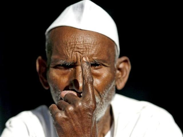 A-man-shows-his-ink-marked-finger-after-casting-his-vote-for-the-general-election-outside-a-polling-station-in-Parla-village-in-Muzaffarnagar-district-in-Uttar-Pradesh-Reuters-Photo