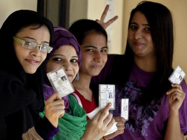 Election-duty-staff-ink-marks-a-voter-s-finger-at-a-poling-booth-in-Bangalore-during-the-Karnataka-Assembly-Election-UNI-Photo