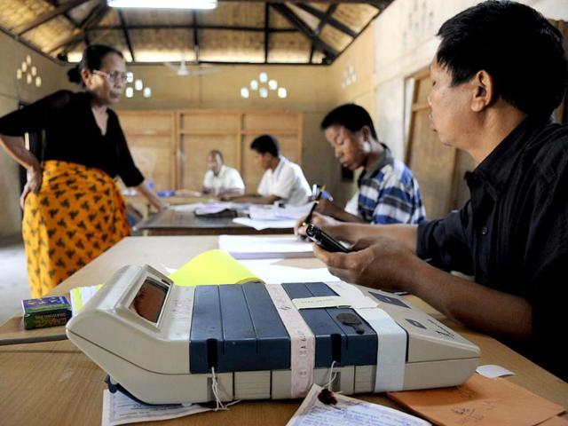 Election-Commission-official-administers-voting-papers-at-a-polling-station-at-Bungthuam-on-the-outskirts-of-Aizwal-in-Mizoram-AFP-photo