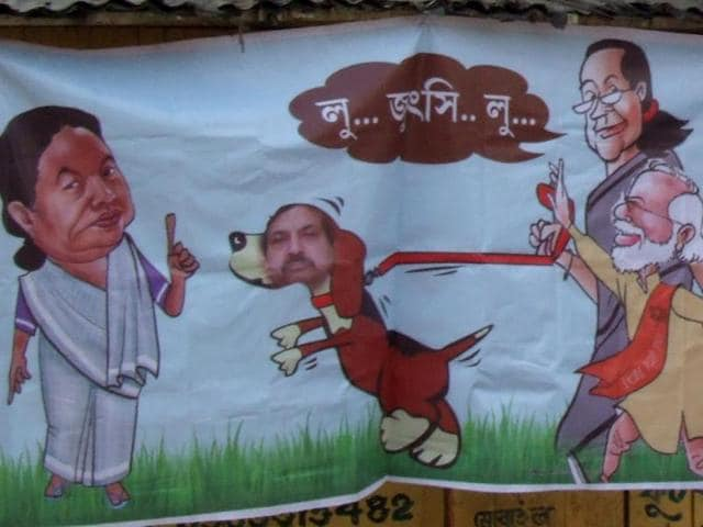 A-poster-showing-Sonia-Gandhi-along-with-Narendra-Modi-trying-to-unleash-a-dog-on-Mamata-Banerjee-has-been-seen-in-Konnagar-West-Bengal-There-is-no-text-saying-who-put-it-up-Sougata-Roy-HT-photo