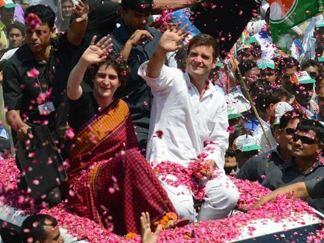 Congress-vice-president-Rahul-Gandhi-and-his-sister-Priyanka-Gandhi-are-showered-with-flower-petals-by-supporters-before-Rahul-filed-his-nomination-for-the-upcoming-Lok-Sabha-elections-in-Amethi-AFP-photo