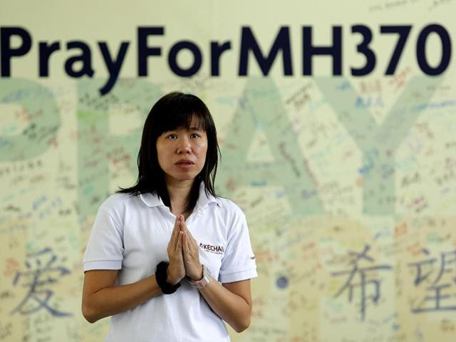 A-woman-prays-for-passengers-onboard-the-missing-Malaysia-Airlines-flight-MH370-at-Kechara-retreat-centre-in-Bentong-outside-Kuala-Lumpur-Reuters-Photo