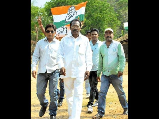 Congress-candidate-for-Singhbhum-Lok-Sabha-seat-Chitrasen-Singh-Sinku-in-white-shirt-visits-different-villages-with-his-supporters-during-a-poll-campaign-in-Hatgamhariya-on-Monday-Arvind-Sharma-HT-Photos
