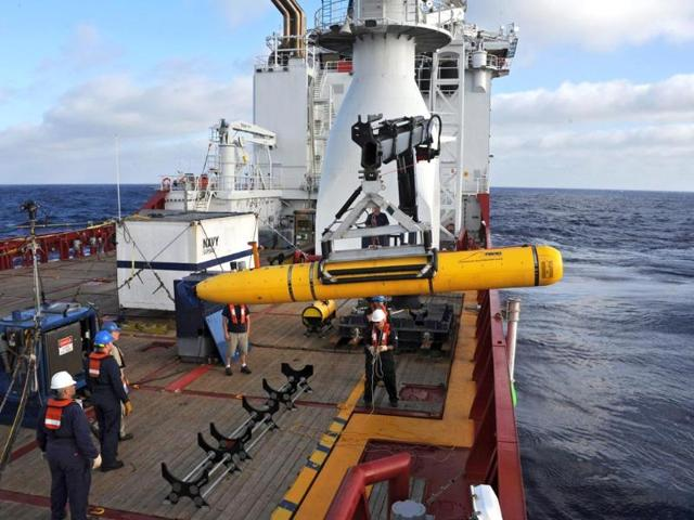 Crew-members-are-seen-aboard-a-fast-response-craft-R-from-the-Australian-Defence-Vessel-Ocean-Shield-L-as-they-continue-to-search-for-debris-of-the-missing-Malaysian-Airlines-flight-MH370-in-the-southern-Indian-Ocean-Reuters-Photo