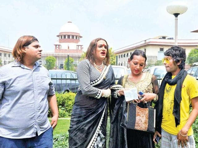 Asia-Pacific-Transgender-Network-founding-member-Laxmi-Narayan-Tripathi-second-from-left-and-others-express-their-happiness-after-the-Supreme-Court-verdict-in-New-Delhi-on-Tuesday-PTI-Photo