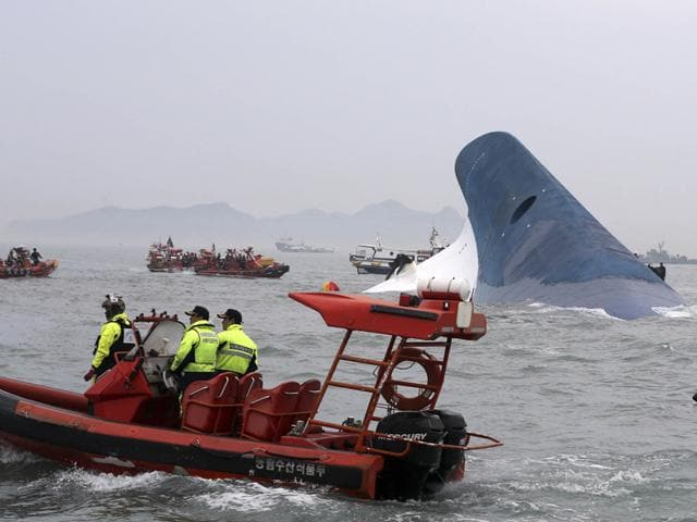 Rescue-workers-install-floats-where-the-capsized-passenger-ship-Sewol-sank-in-the-sea-off-Jindo-Reuters-photo
