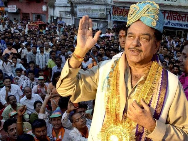 BJP Lok Sabha candidate from Patna Sahib seat Shatrughan Sinha gestures at an election campaign rally in Patna. (PTI Photo)