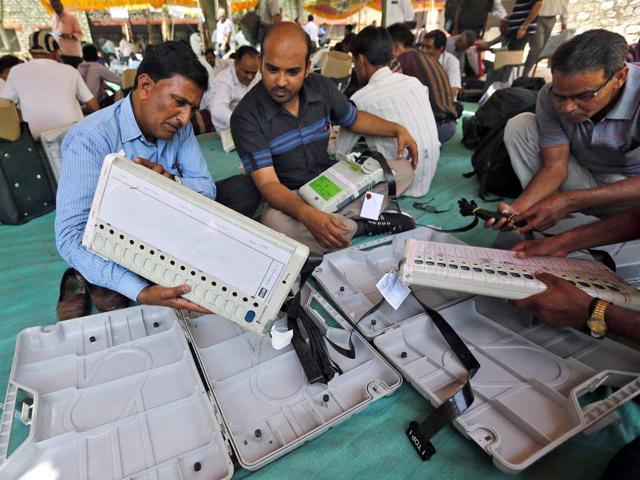 Election-Commission-officials-seal-an-Electronic-Voting-Machine-EVM-prior-to-the-start-of-voting-at-a-polling-station-in-Dibrugarh-Assam-AFP-photo