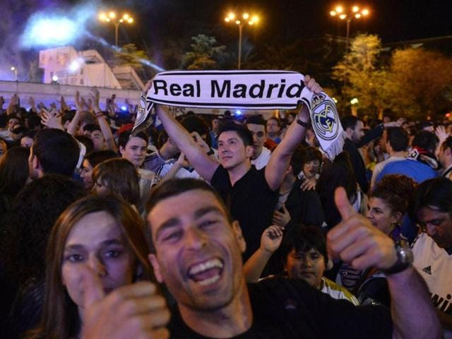 Football-fans-celebrate-Real-Madrid-s-victory-at-Plaza-Cibeles-in-Madrid-after-the-Spanish-Copa-del-Rey-King-s-Cup-final-against-Barcelona-in-Valencia-AFP-Photo