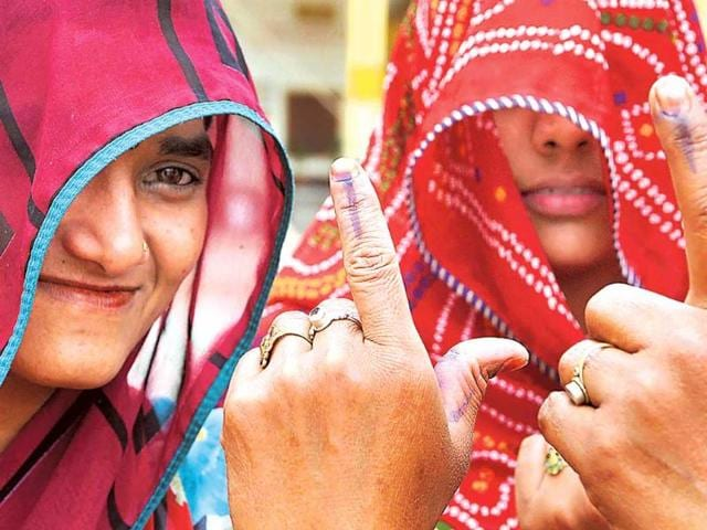 Women-voters-show-their-ink-marker-finger-after-casting-their-votes-on-Thursday-HT-photo