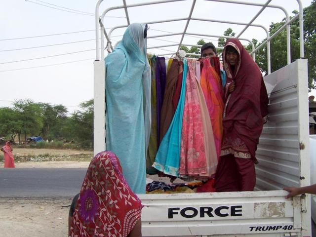 These-boys-from-Jaunpur-are-cashing-in-on-the-demand-for-new-saris-during-election-season-HT-Photo