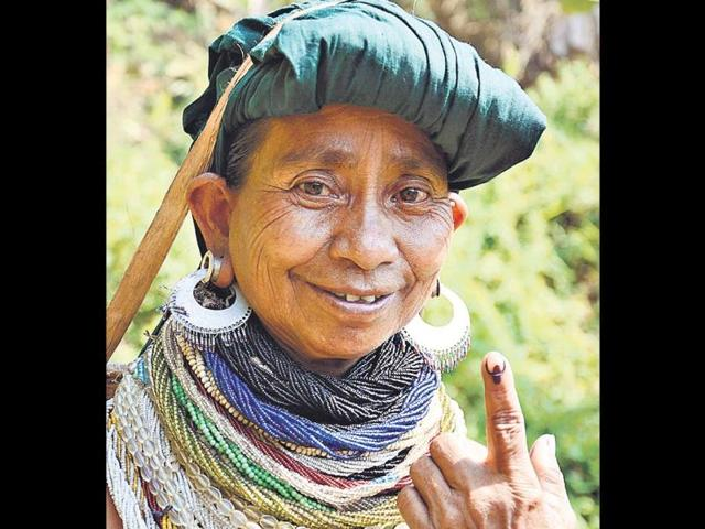 A-Reang-tribal-woman-displays-the-indelible-ink-mark-on-her-finger-after-casting-her-vote-at-a-polling-station-in-Khowai-district-about-120-kilometres-northeast-of-Agartala-Tripura-AP-Photo-Ramakanta-Dey