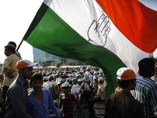 Supporters-of-Congress-holding-a-huge-flag-attend-an-election-campaign-rally-in-Mumbai-Reuters-Photo