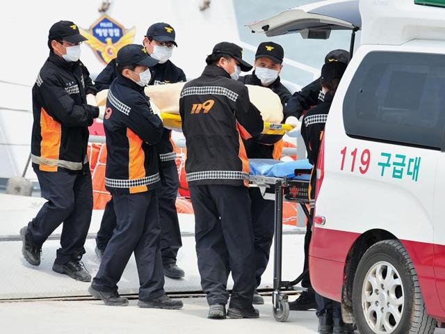 A-family-member-of-a-missing-passenger-onboard-the-Sewol-ferry-which-capsized-on-April-16-cries-as-she-checks-the-newly-announced-list-of-the-dead-at-a-gym-in-Jindo-Reuters-Photo