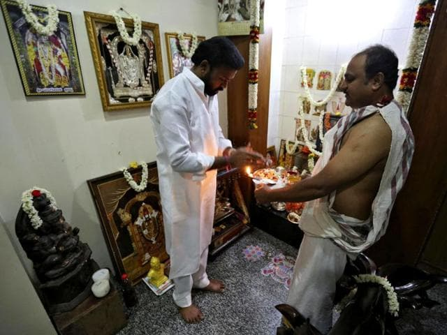 BJP-s-election-candidate-B-Sreeramulu-offers-prayers-in-front-of-a-cow-at-his-residence-in-Bellary-Karnataka-Reuters-photo