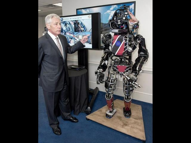 US-Secretary-of-Defense-Chuck-Hagel-is-briefed-on-the-ATLAS-ROBOT-which-is-one-of-the-most-advanced-humanoid-robots-ever-built-at-the-Pentagon-by-Defense-Advanced-Research-Projects-Agency-DARPA-personnel-demonstrating-five-technologies-under-development-AFP-Photo